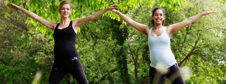 pregnant women exercising in park