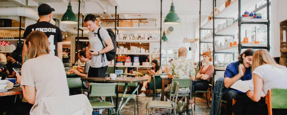Customers sat within a busy coffee shop