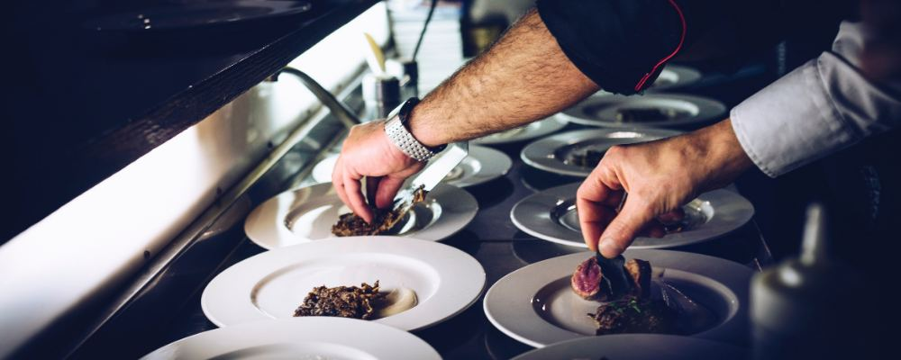 A chef plating up in a restaurant