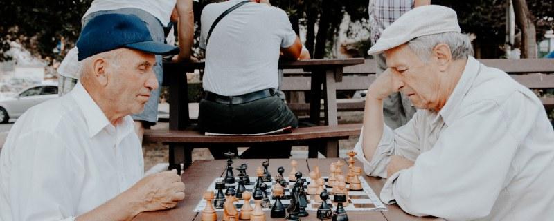 Two senior gentlemen playing chess
