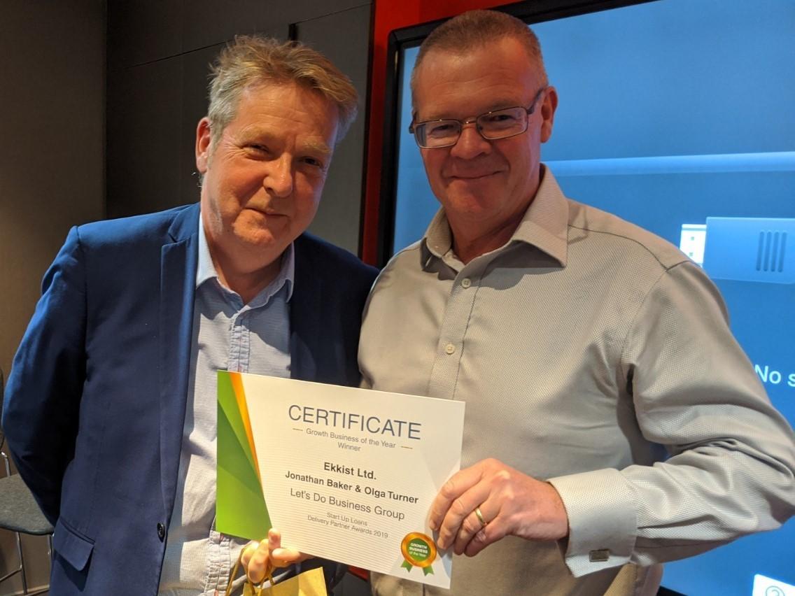 Anthony Turner presenting a certificate to Ekkist Ltd