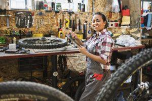 Women fixing bicycles in her workshop